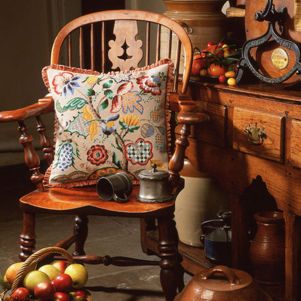 Audley End cushion on antique chair in old kitchen